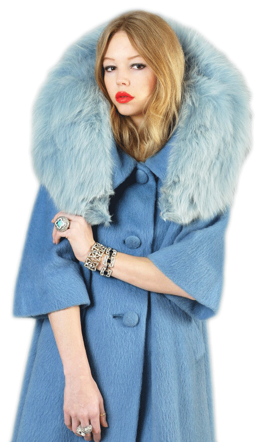 "Top: Carrie Bradshaw, played by Sarah Jessica Parker, wore a vintage raccoon fur coat, in the first season of ""Sex and the City."" Above: Bustown Modern's inventory includes this rare 1950s Lilli Ann trapeze coat with shaggy wool and a fox collar dyed powder blue. (Courtesy of Bustown Modern)"