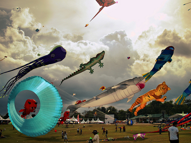 Parafoils shaped like animals seem to leap through the sky at the Pasir Gudang World Kite Festival in Malaysia. A parafoil, a predecessor to the parachute, is a 3-D kite with no sticks. Photo by Amirul Lazan, via Flickr.