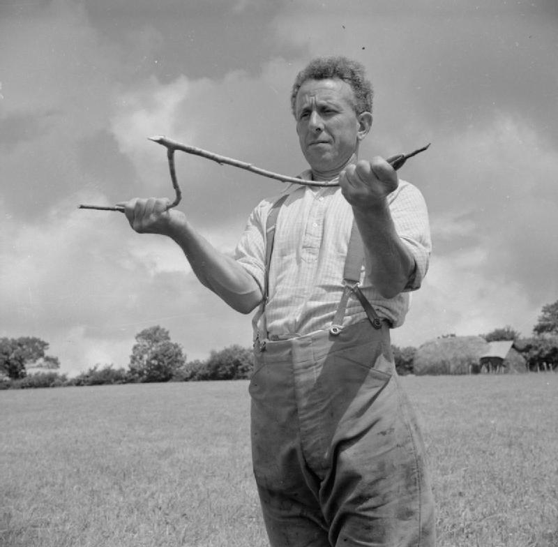 "This photo of Devon farmer George Casely was taken for England's Ministry of Information in 1942. The original caption read: ""Casely has the power of divining and has sunk a well in several of his pastures."""