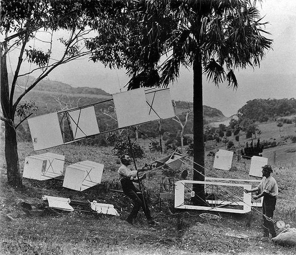 Lawrence Hargrave (seated) and James Swain demonstrate the man-lifting box kites near Stanwell Park beach in November 1894. Photo by Charles Bayliss, via WikiCommons.
