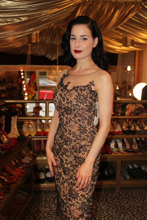 Burlesque star Dita Von Teese, a vintage fashion icon who is a regular customer at The Way We Wore and Decades Inc., tries on a dress. Via Smithsonian Channel.