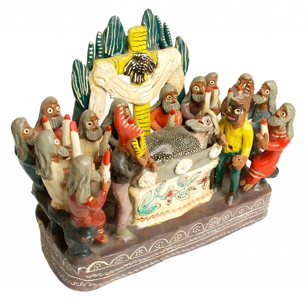 This sculpture seems to show Christ's funeral, observed by the 12 Apostles along with two mysterious, masked figures. Image courtesy Don Lewis.