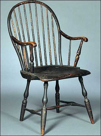 This 18th century American bow-back Windsor armchair sold for nearly $5,000 at Skinner Auction in 2011. The chipping reveals it was painted black over red over green.