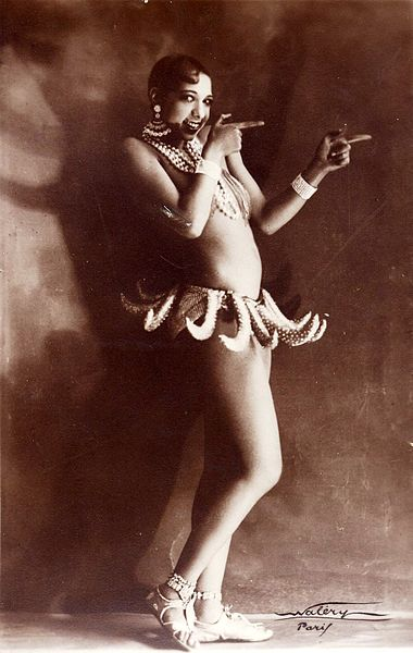Josephine Baker, in her famous banana skirt from the Folies Bergère, was an American who made a name for herself in Paris as an exotic dancer. She became an icon of flapper sexual liberation. Photo by Lucien Waléry, via Wikimedia Commons.