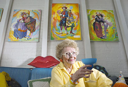Joyce Ballantyne, 86, lifts a martini glass to a reporter at her Ocala, Florida, home in 2004. Photo by Stephen J. Coddington/Tampa Bay Times.
