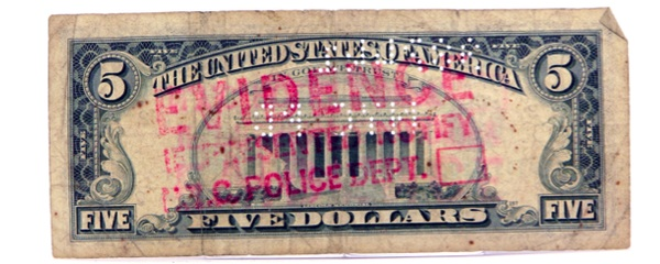 This five-dollar bill was deemed evidence by the New York City Police Department. Via mmuseumm.com