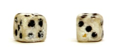 Dice made out of bread by a prison inmate. Courtesy of Museum