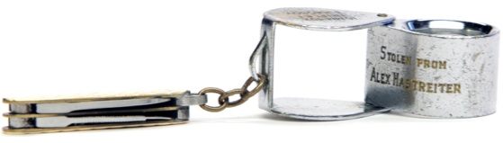 "The jewelry loupe engraved with ""Stolen From Alex Hastreiter."" Courtesy of Museum"