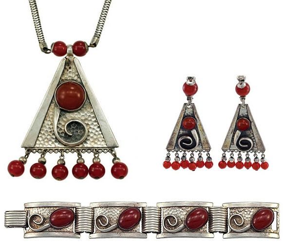 "This modernist 1950s demi-parure features ""hammered"" silver-plated brass and faux carnelian glass stones. (From ""The Napier Co."")"