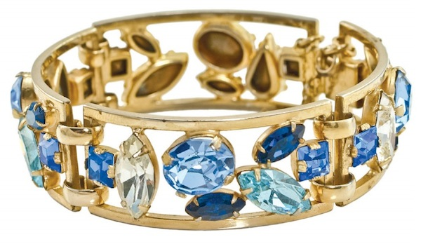 "A 1950s Napier bracelet with ""foil-backed faceted crystal stones"" in shades of sapphire. (From ""The Napier Co."")"