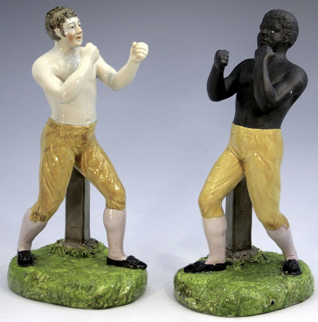 "Top: Schkolne's most enigmatic piece is this ""Menagerie"" scene, depicting a brutal tiger attack. Above: Pugilists or boxers were some of the earliest sporting celebrities made into Staffordshire figures. Photos © Myrna Schkolne 2013"