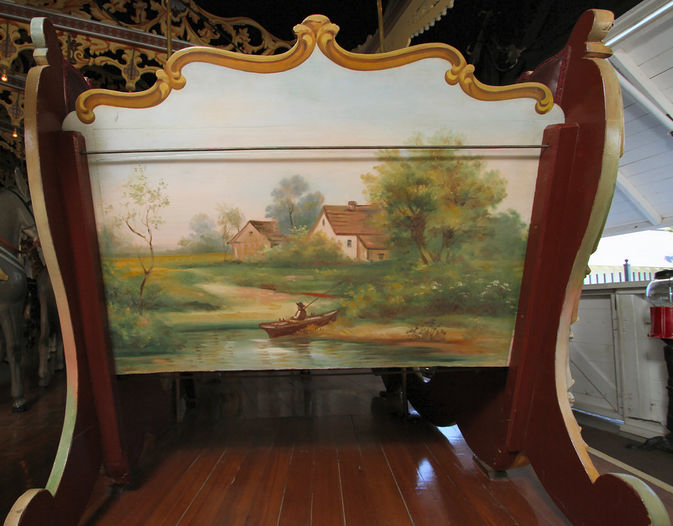 The 1905 Philadelphia Toboggan Company carousel at Kit Carson County Fairgrounds in Burlington, Colorado, has its original paint, including this scene on the back of a chariot. (© Brian Hawkins, via carousels.org)