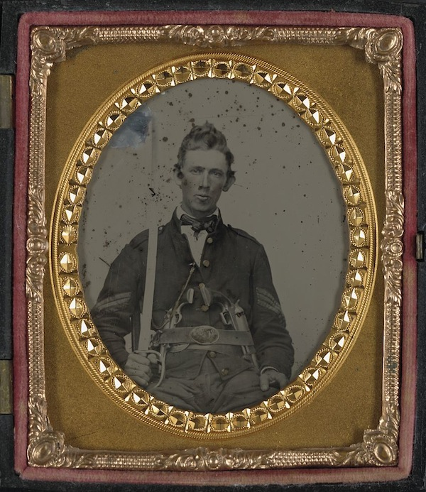 An unnamed Union sergeant is armed with 1st model revolvers, a Colt Dragoon and a Colt Army, as well as a sword in this ambrotype. (From the Liljenquist Family Collection of Civil War Photographs, Library of Congress)