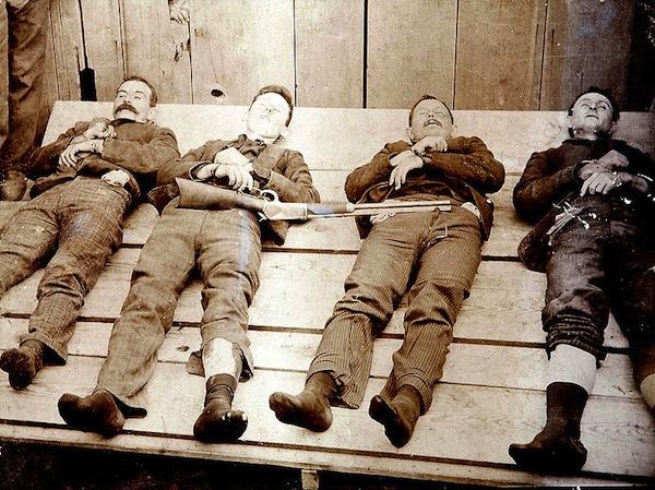 A post-death photo, known as a memento mori, of the Dalton Gang, (from left) Bill Power, Bob Dalton, Grat Dalton, and Dick Broadwell. (From Cramers Art Rooms of Cherryvale, Kansas, via WikiCommons)