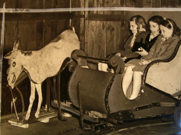 "A plywood ""Kicking Mule"" stunt spooks little girls in Harry Traver's Laff in the Dark, which operated at Kennywood amusement park in West Mifflin, Pennsylvania, from 1931 to 1965. (Courtesy of LaffintheDark.com)"