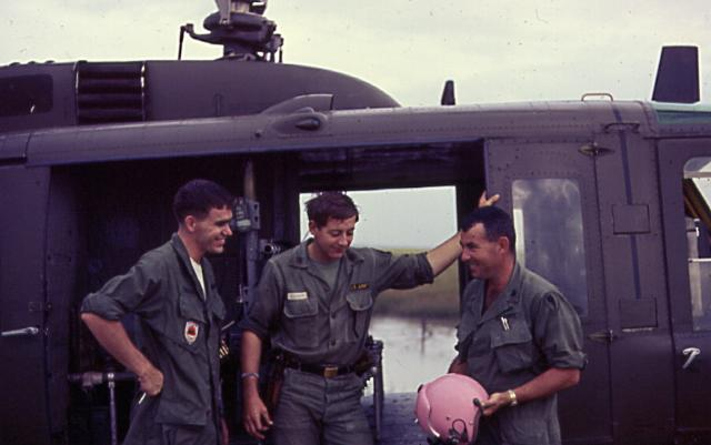 "Chief Warrant Officer 2 Lowell L. Eneix recalls, ""They had presented me with a freshly painted helmet. It was the most perfect titty pink color, they had mixed and experimented for about a week to get that color. They were proud and so was I."" (Courtesy of Eneix, via VHPAMuseum.org)"