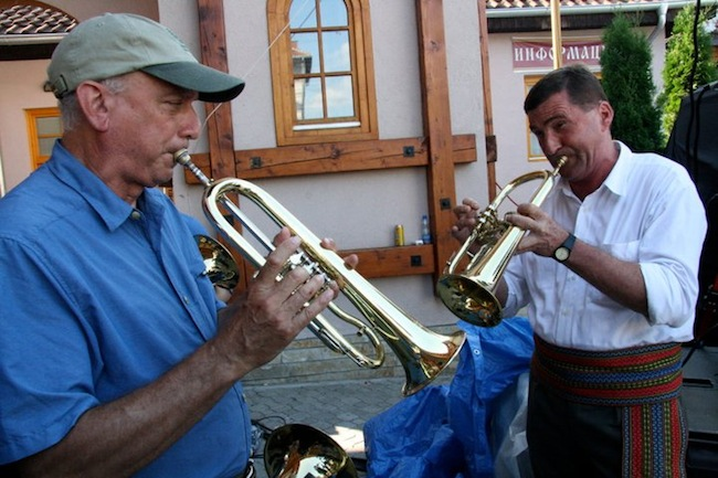 "Zlatne Uste director and co-founder Michael Ginsburg plays flugelhorn with a member of Ćerimović's band. (Via the ""Brasslands"" Facebook page)"