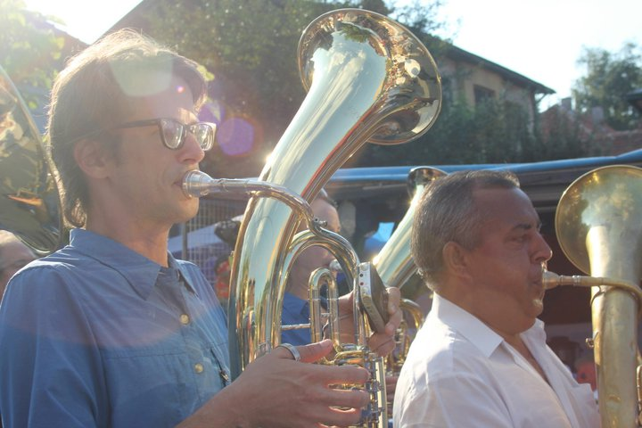"Zlatne Uste baritone player Don Godwin, at left, performs in Guča's streets. (Via the ""Brasslands"" Facebook page)"