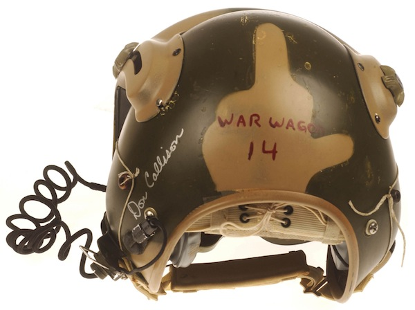 """Doug Callison traded for this dual-visor helmet with an Air Force friend, who also got it painted camouflage colors for him. The painter, """"couldn't wait to turn the helmet around to show me his handiwork on the backside. He had blended in a tan 'Bird' or 'The Finger' on the back. I was elated, to say the least! I could simply turn my head to let those next me know that they were #1 with me too."""" (Courtesy of Callison, restored by Don Mong, via VHPAMuseum.org)"""
