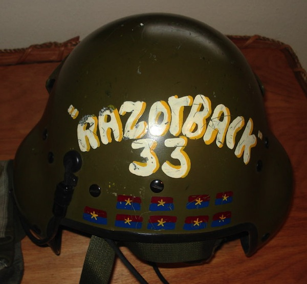 "A rare example of a Vietnam helicopter helmet painted with a count, mostly like ""KBAs,"" or enemies confirmed ""killed by air,"" designated with the Viet Cong flag. (Courtesy of Steve ""Tooth"" Bookout, via VHPAMuseum.org)"