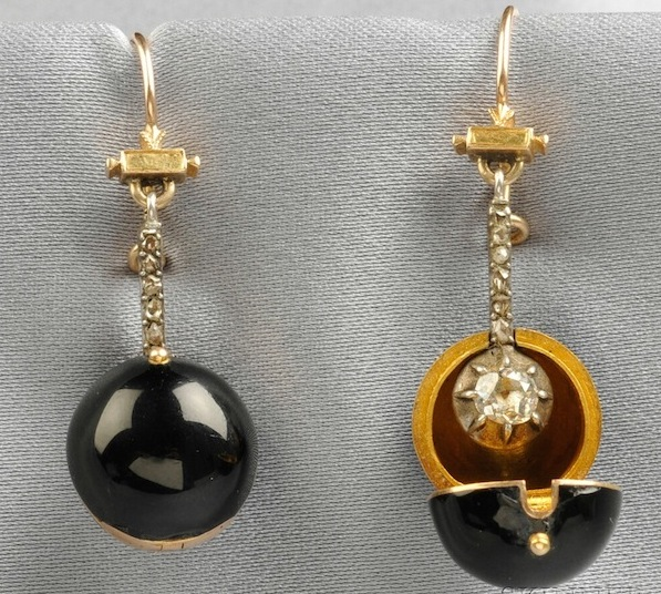 In the late 1800s, detachable orbs known as coach covers were used to disguise diamond drop earrings during the daytime or while traveling. (The Hairpin, via Skinner Auctions)