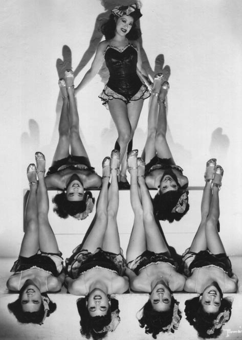 The Forbidden City chorus girls show off their legs, which was quite a titillating thing to do in the 1940s.