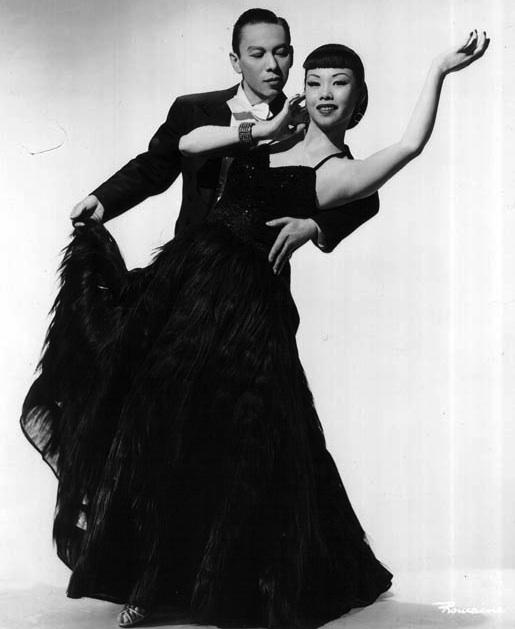 Husband-and-wife dance team Mai and Wilbur Tai Sing. Mai told Trina Robbins she loved elaborate costumes, like this dress made of 85 yards of monkey fur.