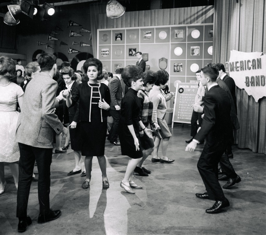 Girls in boxy sack dresses on the set of American Bandstand, circa 1965.