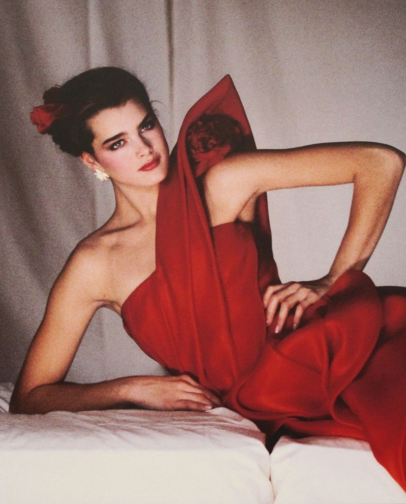Brooke Shields models a Valentino dress with a pointed shoulder detail in 1981.