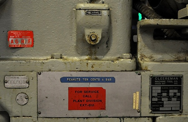 "A variety of tags on the side of the Cleereman drill press. The blue ""peanuts"" label was put on the machine by someone at NARF."