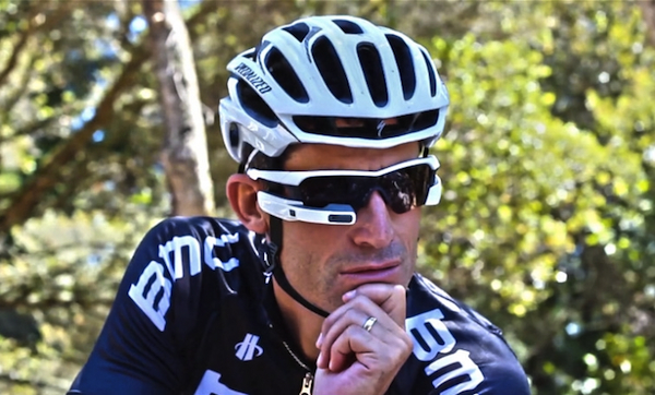 Top: Google Glass, without the glass. In much of its marketing materials, Google has been careful to position its users as the opposite of creepy male glassholes. Above: The Recon Jet seems designed for professional cyclists like George Hincapie.