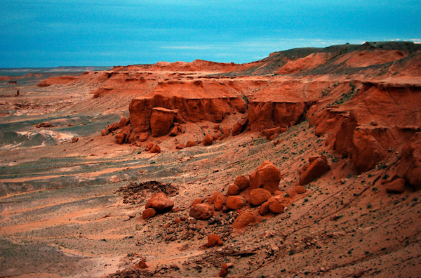 The Flaming Cliffs of the Gobi Desert have been luring Western paleontologists since the 1920s. Photo by Kevin and Jennifer of Two Years Off.