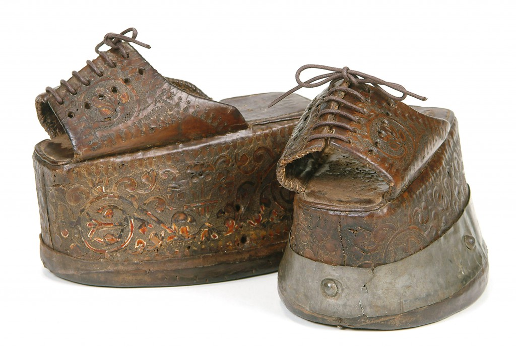 This pair of chapins, the Spanish version of chopines, has cork platforms covered in elaborately tooled leather. Image courtesy the Bata Shoe Museum.