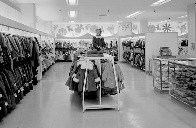 Top: The Art Deco exterior of Bullock's Wilshire luxury department store in Los Angeles, built in 1929, was designed by architects John and Donald Parkinson. (Via TenOver6.com) Above: The Raymond Loewy-designed interior of the girls' clothing department in Bloomingdale's in Hackensack, New Jersey, in 1959. (Via the Gottscho-Schleisner Collection at the Library of Congress)