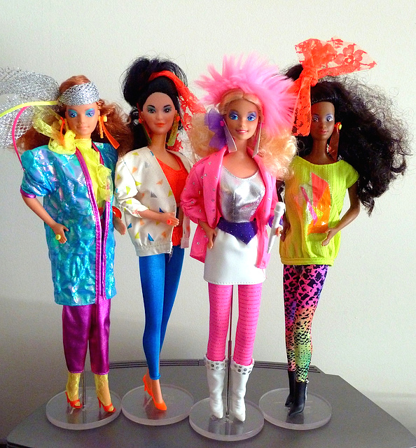 Barbie and the Rockers, from left, Diva, Dee Dee, Barbie, and Dana. The famous doll's 1985 update came with clothes and bandmates strikingly similar to Jem's. (Via Addicted2Cuteness' Flickr)