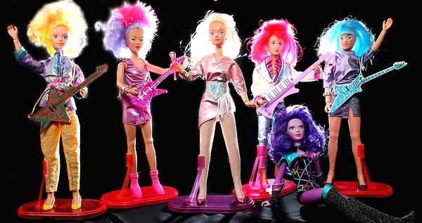 The original 1986 Hasbro Jem and the Holograms dolls with, from left, Video, Shana, Jem, Kimber, supercomputer Synergy, and Aja. (Via Allyeska's Flickr)