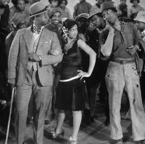 "Nina Mae McKinney with William E. Fountaine and Daniel Haynes in a still from the 1929 film ""Hallelujah!"""