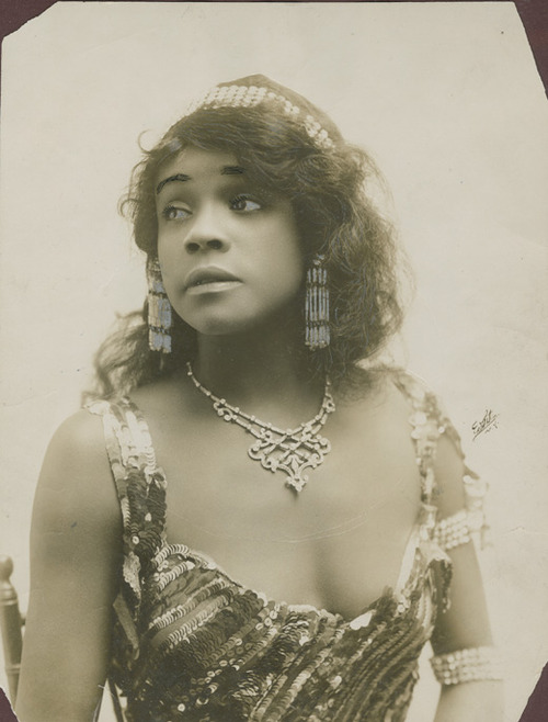Ada Overton Walker is credited with popularizing the cakewalk, the 19th century dance craze that originated on slave plantations. In this photo, she's dressed as her Salome character. (From the New York Public Library for the Performing Arts)
