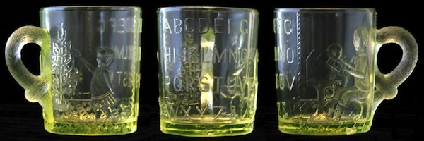 "An Adams & Co. Vaseline glass mug to help children learn their ABCs, circa 1880s. Photo via Dave Peterson at <a href=""http://www.vaselineglass.org/"">VaselineGlass.org</a>"