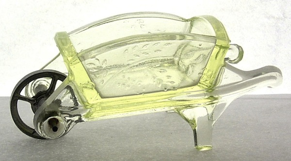 "During the Victorian Era, glassmakers such as Adams & Co. of Pittsburgh, Pennsylvania, produced novelty items like this wheelbarrow, which could have been used as a salt or to hold matches. Photo via Dave Peterson at <a href=""http://www.vaselineglass.org/"">VaselineGlass.org</a>"
