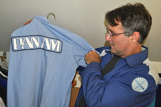 "Lappin shows a Pan Am work shirt while wearing a mod-style Pan Am jacket from the late '60s that he describes as ""something out of a '60s sci-fi movie."" (Photo by Lisa Hix)"