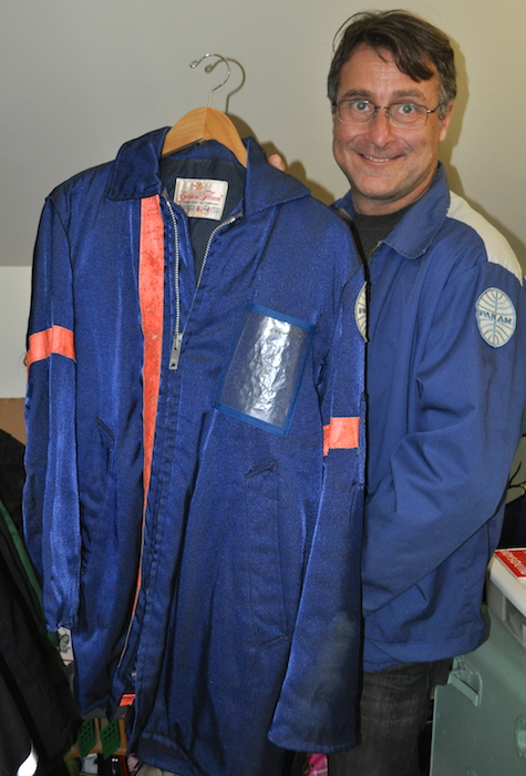 Lappin holds up a winter-weight Pan Am jacket. (Photo by Lisa Hix)