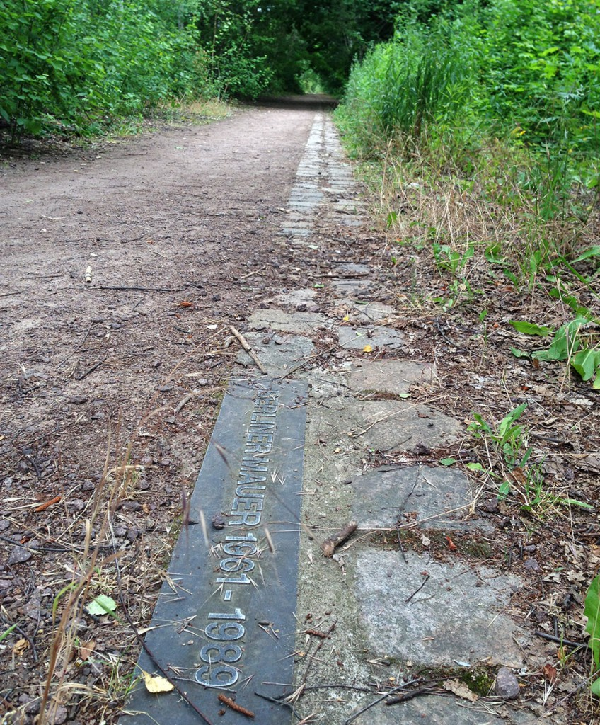 Today, the former path of the Berlin Wall's is followed by a cobblestone marker throughout the city.