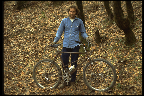 Joe Breeze with Breezer #1 at the bottom of Repack, after winning the race on the bike's first ride down the road, 1977.
