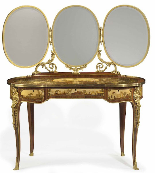 Huguette's 1990s replica of her mother's French ormolu-mounted tulipwood, bois satine, sycamore, and fruitwood marquetry and parquetry dressing table with three folding oval mirrors, The original from the early 20th century sold for $87,500 and the modern version sold for $8,700. (Via Christies.com)
