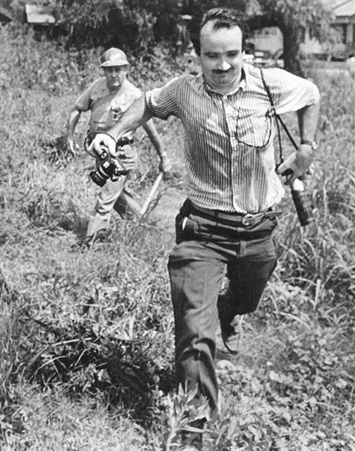 "Top: Protesters at the 1963 March on Washington, captured by photographer Marion S. Trikosko. Via the Library of Congress. Above: Bob Fitch snapped this picture of a sheriff's deputy pursuing photographer Matt Herron during a protest in Philadelphia, Mississippi, in 1966. Courtesy the <a href=""http://library.stanford.edu/collections/bob-fitch-photography-archive"">Bob Fitch Photography Archive</a>."