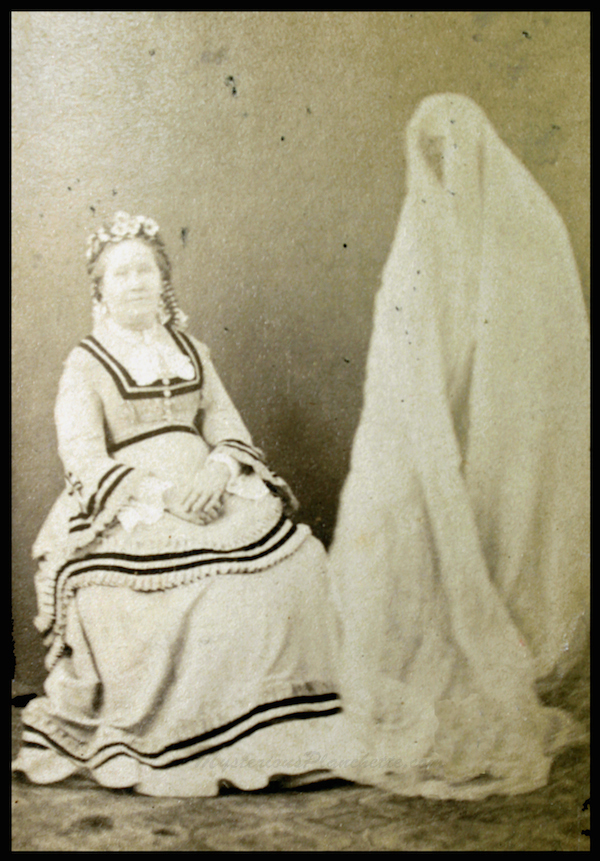 This 1872 spirit photograph shows Mrs. Pearson with the purported spirit of her sister, as manifested by the medium Georgiana Houghton. Photo by Frederick Hudson. (Courtesy of MysteriousPlanchette.com)