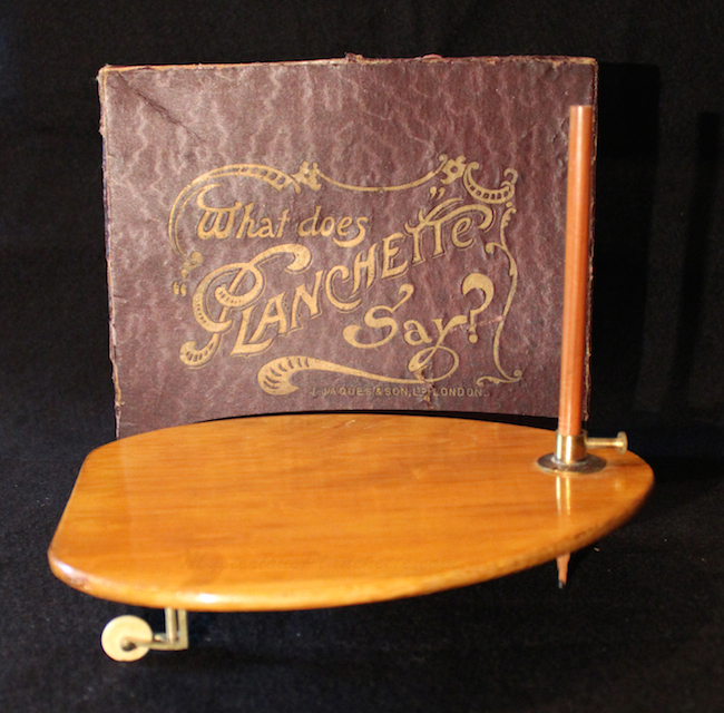 "This ""What Does Planchette Say?"" device was produced by the London toy company Jaques & Son in 1900. (Courtesy of MysteriousPlanchette.com)"