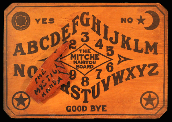 In the 1920s, the Wilder Manufacturing Company produced The Mitch Manitou talking board. (Photo courtesy Andrew Vespia Collection, via MysteriousPlanchette.com)