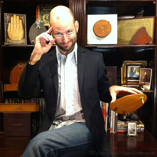 Brandon Hodge, the creator of MysteriousPlanchette.com, with his collection of Victorian spirt-communication devices. (Courtesy of MysteriousPlanchette.com)